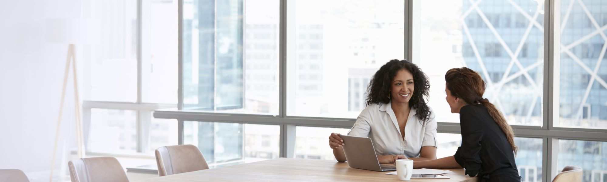 business women having a one on one in conference room